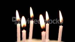 Focus on birthday candles being blown out