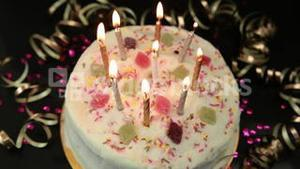 Hand lighting candles on birthday cake