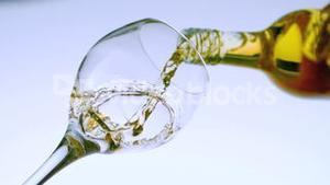White wine pouring into a glass low angle view
