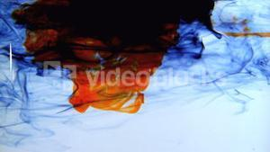 Blue orange and black ink swirling in water