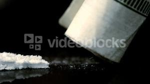 Close up of line of cocaine being snorted