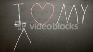I love my mum message appearing drawn on blackboard with chalk