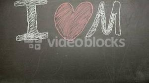I love my dad message appearing drawn on blackboard with chalk