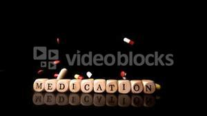 Different tablets rolling over dice spelling medication