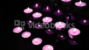 Pink candles at alter blowing out