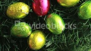 Easter eggs packed in aluminium in the grass