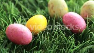 Easter eggs dropping in the grass