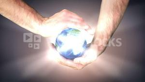 Earth spinning in mans hands
