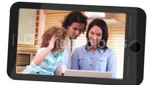 Smarphone screens showing family using laptop