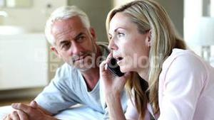 Couple expecting a phone call and getting it