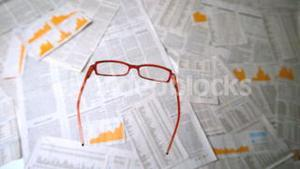 Glasses falling on papers