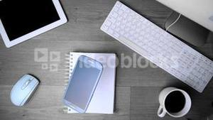 Smartphone phone falling on office desk in black and white