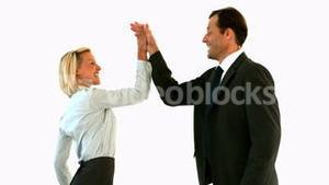Business people high fiving each other
