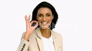 Businesswoman giving ok sign