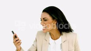 Businesswoman screaming down her mobile phone