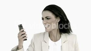 Businesswoman screaming down her mobile phone in black and white