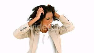 Stressed businesswoman tossing her hair