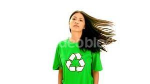 Serious woman wearing green shirt with recycling symbol on it