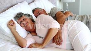 Mature couple sleeping together