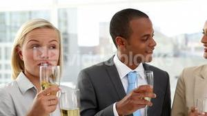 Business people celebrating with champagne