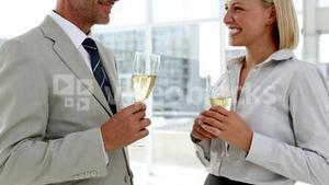 Business partners celebrating with champagne