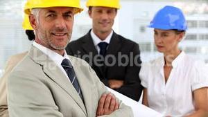 Confident architect with arms crossed