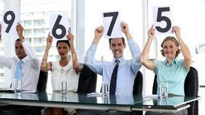 Business people showing scores