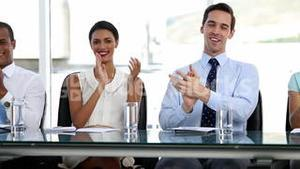 Business people applauding in office
