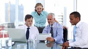 Group of business people using laptop and tablet computer