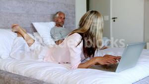 Confused wife asking something to her husband