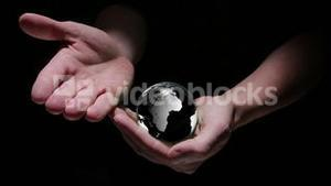 Animation of hands revealing globe earth