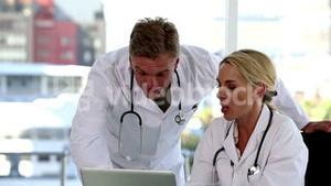 Team of doctors working on a computer