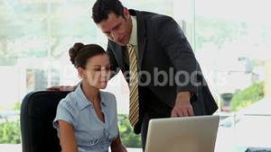 Businessman explaining the work to colleague