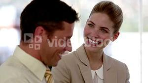 Business people discussing and laughing
