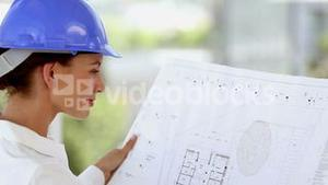 Female architect smiling to the camera