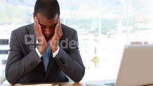 Businessman looking overworked and exhausted
