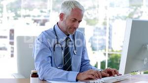 Smiling doctor working in office