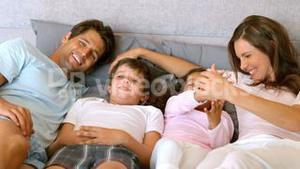 Happy family lying in a bed