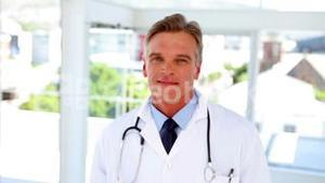 Doctor walking into focus and smiling
