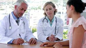 Doctors explaining something to patient