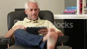 Man relaxing with his tablet