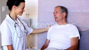 Home nurse talking with patient