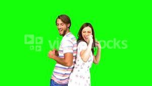 Friends dancing back-to-back on green screen