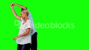 Lovers dancing together on green screen