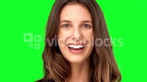 Surprised woman smiling on green screen