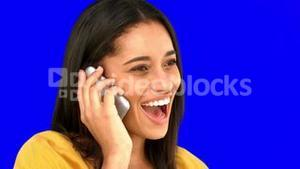Woman talking on the phone on blue screen