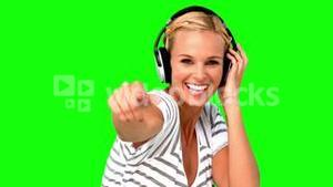Smiling woman pointing at the camera on green screen