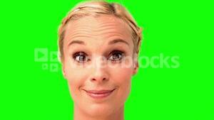 Woman smiling and looking at the camera on green screen