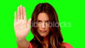 Woman showing the stop sign with her hand