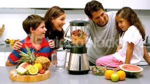 Family using a blender together
